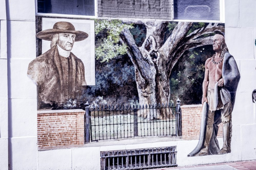 Illustration of Salem Oak Tree with a man on each side and fence in the center