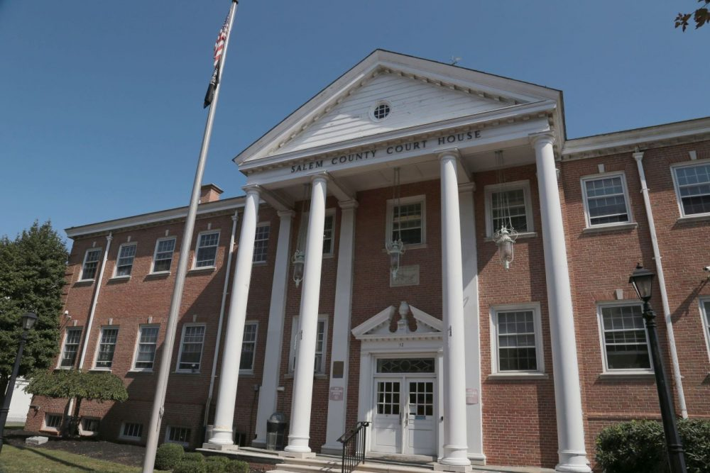 Front of Salem County Court House building with flag pole in front